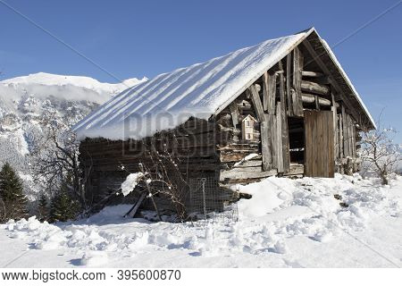 A Snowed In Decayed Barn In The Swiss Alps On A Sunny Winters Day