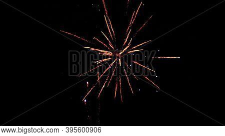 Fireworks Lights On A Black Background.festive New Year Fireworks In The Night Sky.new Year Holiday.