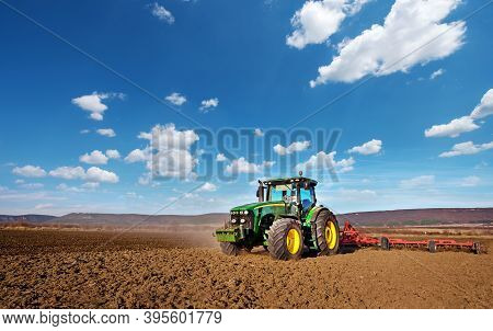 Varna, Bulgaria - March 5, 2017 Ploughing A Field With John Deere 6930 Tractor. John Deere Was Manuf