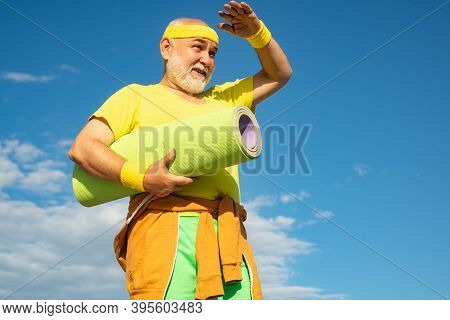Healthcare Cheerful Lifestyle. Grandfather Sportsman On Blue Sky Backgrounds. Senior Man In Health C