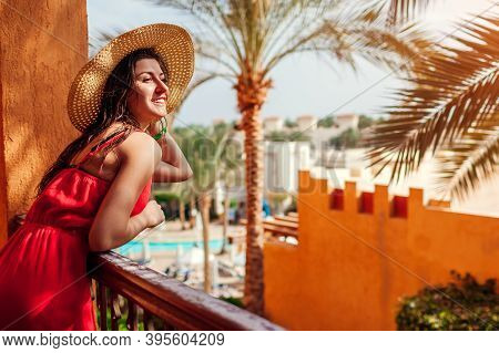 Young Woman Enjoying Swimming Pool, Palms View From Hotel Balcony In Egypt. Vacation In Tropical Res