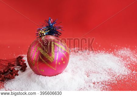 Beautiful New Yechristmas Red Ball On Red Background. Web Design. For Blog Ars Red Ball On The Snow