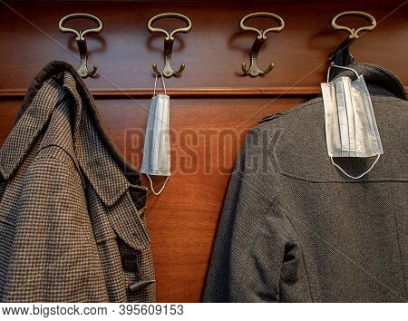 New Norm. Medical Disposable Masks On A Hanger In The Hallway Next To The Coat. Rules Of Conduct Dur