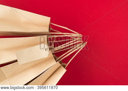 Shopping Concept. Top Above Overhead View Close Up Photo Of Four Craft Paperbags With Paper Tag Isol