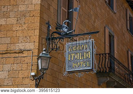 Orvieto, Italy - May 17, 2013. Close-up Of Elaborate Hotel Plate, Made Of Iron, Stuck In Stone Wall