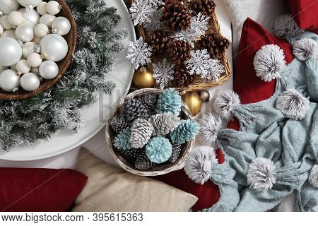 Top View Christmas Decorations Centerpiece With Garland And Balls Near A Basket With Colorful Pine C