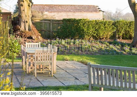 Garden Patio Furniture In Wintertime, A Large Back Garden In Rural Buckinghamshire, Uk