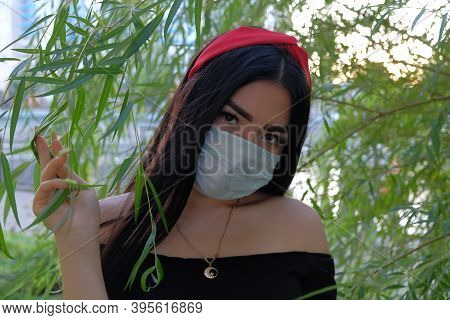 Medical Mask Asian Girl. Covid Epidemic Time
