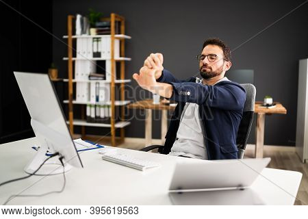 Stretch Exercise At Office Stretches While Sitting On Chair
