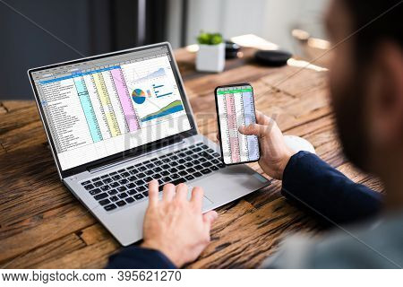 Analyst Employee Using Spreadsheet On Computer Screen