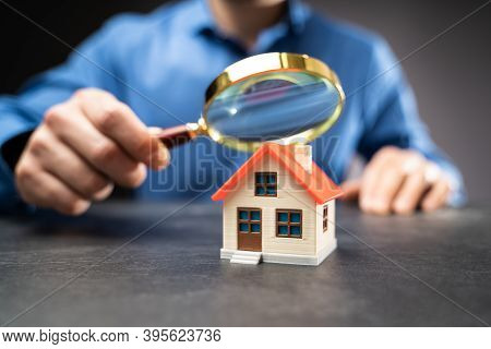 House Or Home Inspection Using Magnifying Glass. Tax And Insurance
