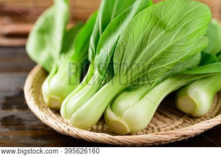 Fresh Bok Choy Or Pak Choi (chinese Cabbage) In Bamboo Basket On Wooden Background, Organic Vegetabl