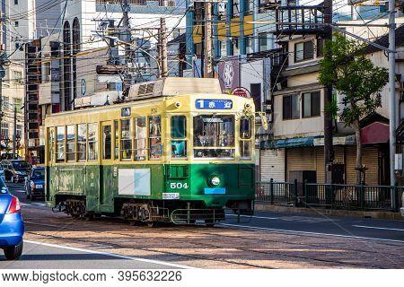 Nagasaki, Japan - 4 November 2020: Yellow And Green Tram In Nagasaki