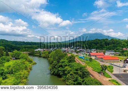 Hokkaido, Japan - July 14 2018 : Townscape Of Niseko In Springtime Sunny Day With Mount Yotei In The