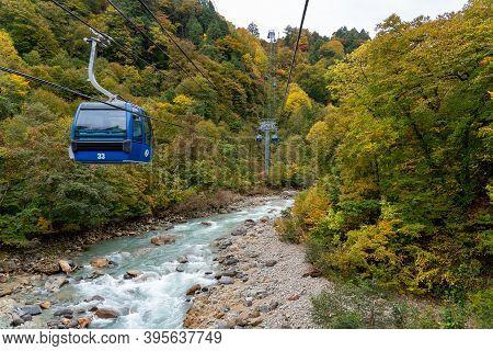 View Of Mountains And Valleys From The Dragondola (naeba-tashiro Gondola) In Autumn Foliage Season.