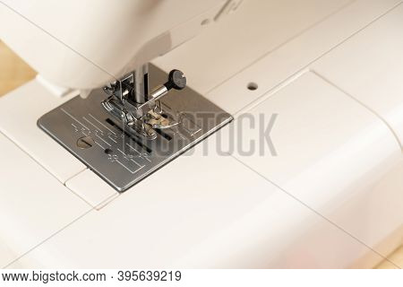 Close-up Of A Sewing Machine. View Of The Sewing Machine Foot. Free Space For Text