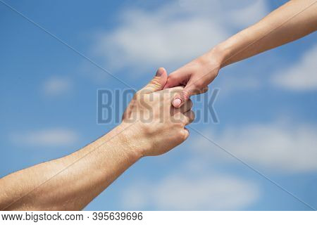 Hands Of Man And Woman Reaching To Each Other, Support. Solidarity, Compassion, And Charity, Rescue.