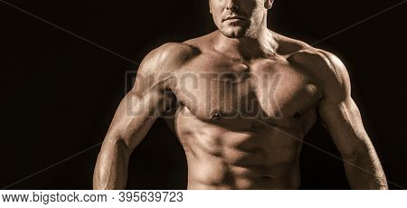 Strong Athletic Man Showing Muscular Body And Sixpack Abs. Showing Muscular Torso
