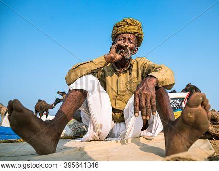 November 2019 Pushkar,rajasthan,india. Portrait Of Man Smoking At Pushkar Camel Festival.