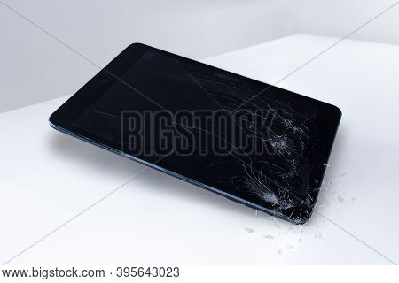 Calgary, Alberta, Canada. Nov. 19, 2020. An Ipad With A Broken Screen On A White Surface.