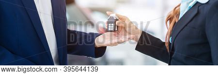 Auto Business Banner Background, Close Up Of Dealer Giving Key To New Owner In Auto Show Or Salon, C