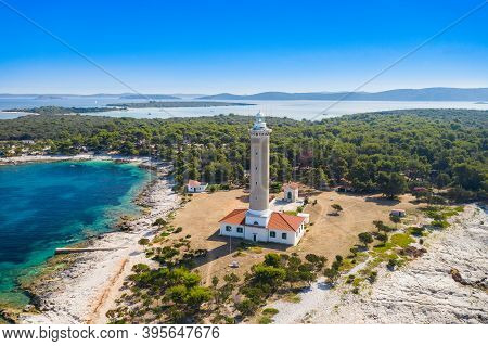 Pine Forest And Old Lighthouse Of Veli Rat On The Island Of Dugi Otok, Adriatic Sea Horizon In Backg
