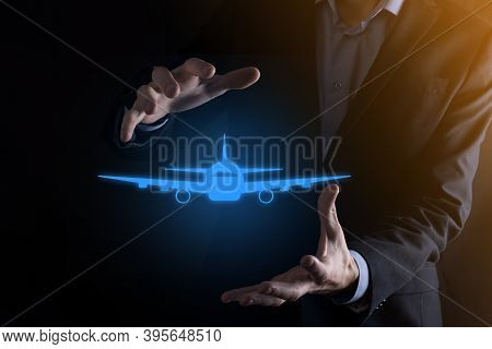 Businessman Holding An Airplane Icon In His Hands. Online Ticket Purchase.travel