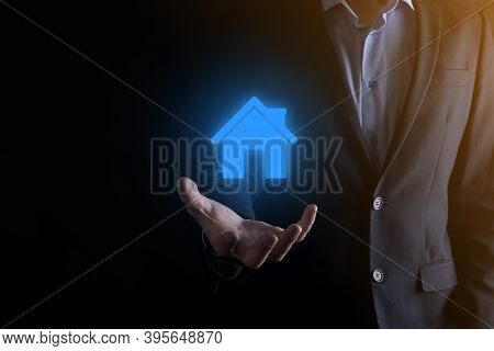 Real Estate Concept, Businessman Holding A House Icon.house On Hand.property Insurance And Security