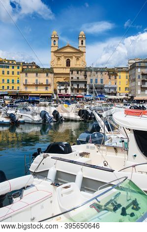 View On église Saint Jean-baptiste In Bastia From The Vieux Port With Some Boats Resting In The Habo