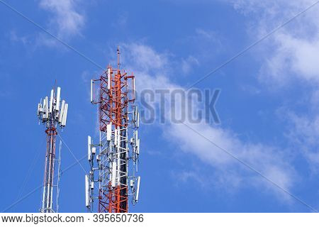 Telecommunication Tower With Bright Blue Sky And Clouds Background. Satellite Dish Telecom Network F