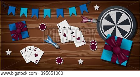 Top View Of A Wooden Table With Items For Gambling And Sports Games. The Card For Party With Present