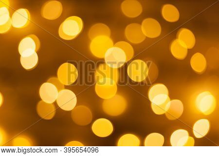 Festive Garland Bokeh Background Defocused. Background For Greeting Cards And Postcards. Round Bokeh