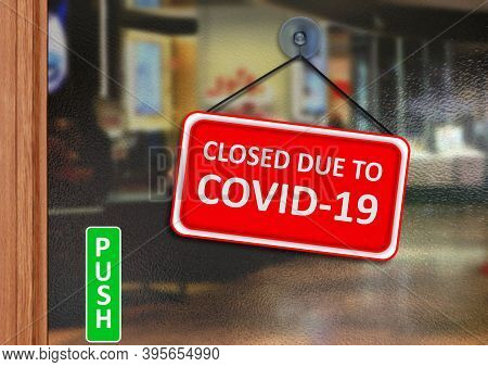 Close Signage Due To Covid 19 On A Glass Door