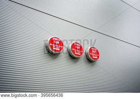 Fire Sprinklers On The Wall Of The Industrial Hall