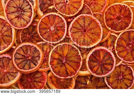 Close Up Many Dried Crispy Red Blood Orange Ring Chips On Retail Display, Elevated Top View, Directl