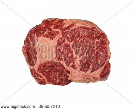 Close Up One Marbled Raw Ribeye Beef Steak Isolated On White Background, Elevated Top View, Directly