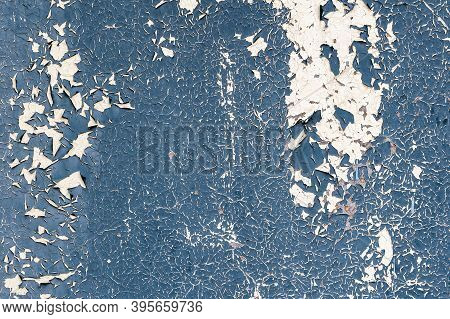 Abstract Blue And White Texture With Grunge Cracks. Cracked Paint On A White Surface. Bright Urban B