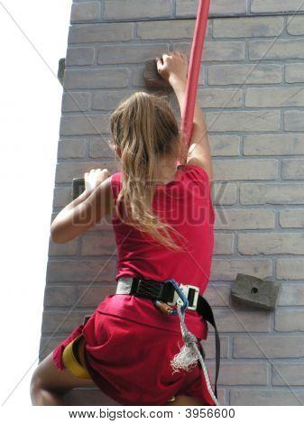 Girl On Rock Wall