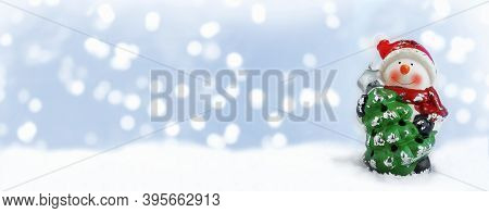 Happy Snowman Standing In Winter Christmas Landscape. Merry Christmas And Happy New Year Greeting Ca