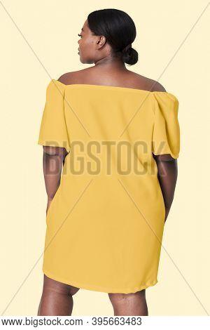 Woman facing backward yellow dress plus size apparel fashion mockup