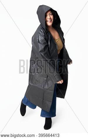 Women's black raincoat mockup fashion shoot in studio