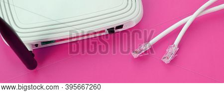 Internet Router And Internet Cable Plugs Lie On A Bright Pink Background. Items Required For Interne