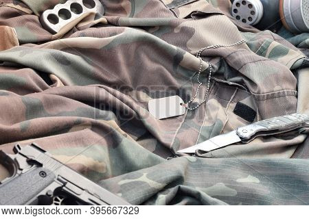 Stalker Soldiers Soviet Gas Mask Lies With Handgun And Knife On Green Khaki Camouflage Jackets