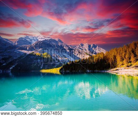 Nice view of the azure lake Oeschinensee. Location place European Alps, Kandersteg, Bernese Oberland, Switzerland, Europe. Popular tourist attraction. Photo wallpaper. Discover the beauty of earth.