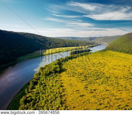 Attractive view from a drone flying over the sinuous river. Location place Dnister or Dniester canyon of Ukraine, Europe. Vibrant wallpaper. Exotic nature photography. Discover the beauty of earth.