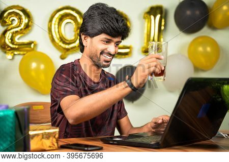 Young Man Partying During New Year Or Christmas Celebration Video Call On Laptop - Concept Of Distan