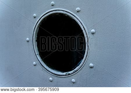 Port Hole On A Riveted Steel Ship.