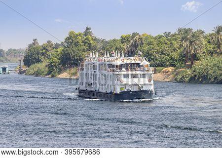 Aswan, Egypt - September 13, 2018: A Tourist Boat Motor Down The River Nile Towards Aswan In Central