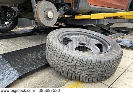 Car Repair Concept. Technicians Are Changing Tires. Wheel Balancing Or Repair And Change Car Tire.