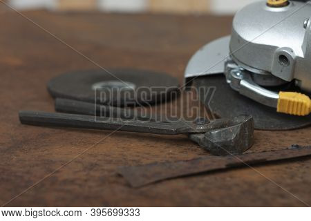 Black Splitting Pliers And  Angle Grinder With Thinner Cut-off Disc And  Grinding Disc On  Old Rusty